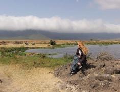 Eva is sitting on the rocks in crater Ngorogoro