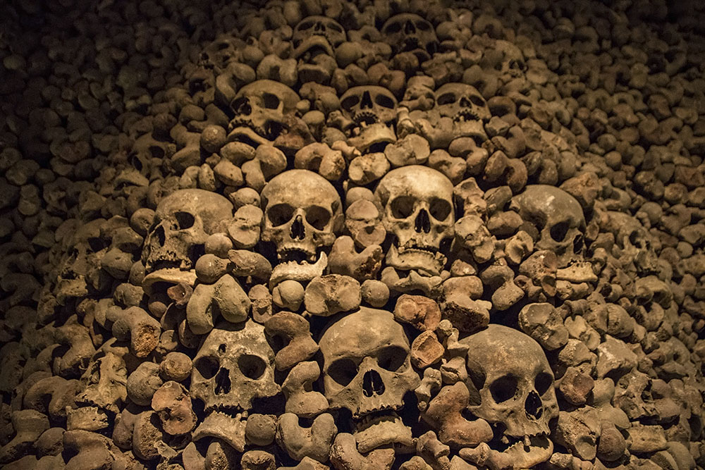 One of the ossuary walls filled with bones and skulls