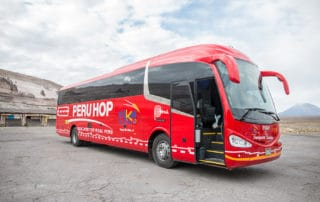 Typical red bus Peru Hop